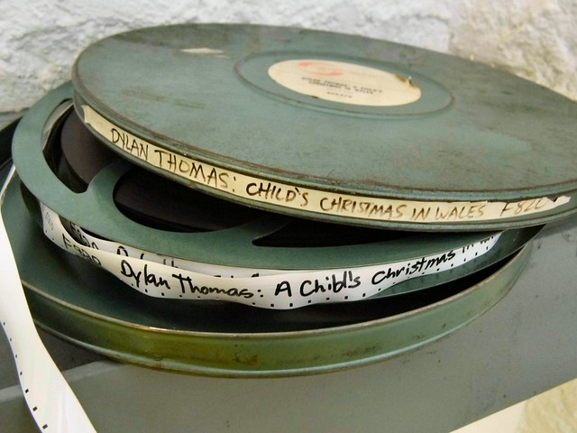 Two gray-green film reels with misspelled labels