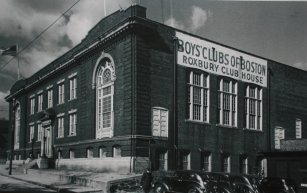 "An old-fashioned building with a sign reading ""Boy's Clubs of Boston"""